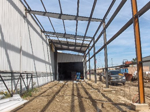 Industrial-Building-Addition_Insatallation-Of-Roof-Panels-And-Soffit-Insulation-ColB1-103-Picture-3