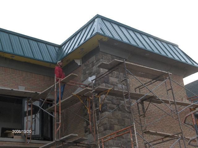 Rosie-O-Gradys_Synthetic-Stucco-Work-On-Exterior-Face-Of-Building-Part2-RosO1-101-Picture-1