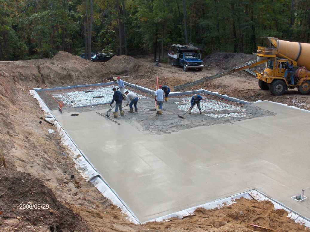 basement slab concrete placement for stehr house in highland twp